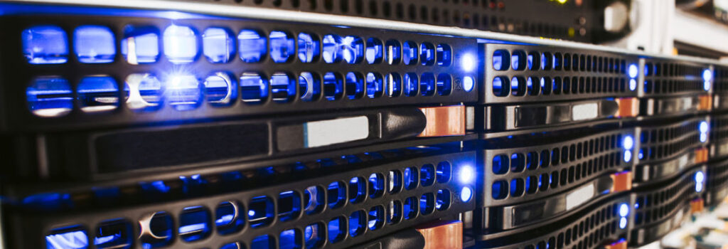 close up of data system storage with blue lights 303 Networks